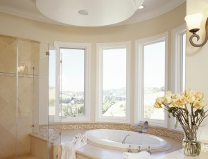 Showcase custom vinyl casement windows add both drama and light to this contemporary bath