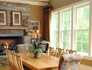 Maintenance-free, double-hung vinyl windows from Showcase highlight this elegant dining room