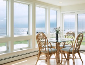 Showcase Custom Vinyl Windows and Doors create a peaceful sunroom on the Gulf coast