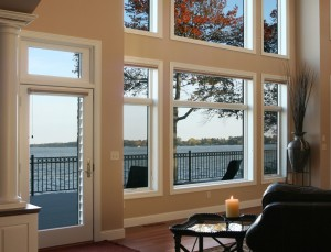From floor to ceiling, Showcase custom vinyl windows make this a stunning great room