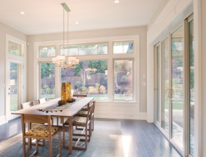 The Earthwise patio door, picture window, casement windows and transoms define this beautiful dining room